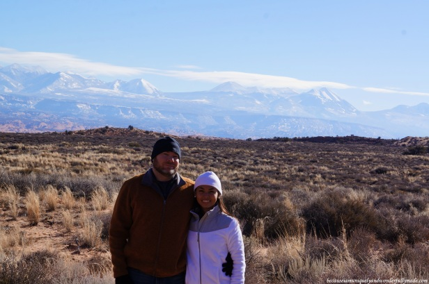 At the La Sal Mountains Viewpoint in Arches National Park in Utah with a majestic a majestic view of the La Sal Mountains in the distance.