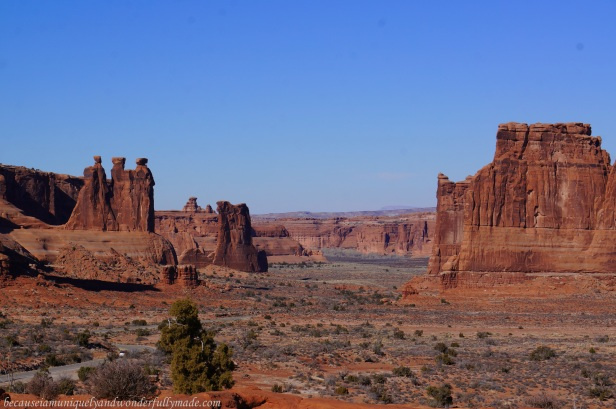 View of the famous rock formations called Three Gossips, Sheep Rock, the Organ, and the Tower of Babel from The Courthouse Towers Viewpoint in Arches National Park in Utah.