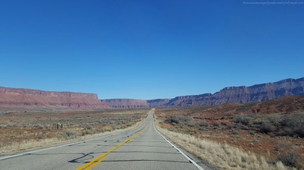 Driving on the scenic 44 mile long Utah State Route 128, also famous as the Upper Colorado River Scenic Byway in Moab, Utab, USA to see the Fisher Towers.