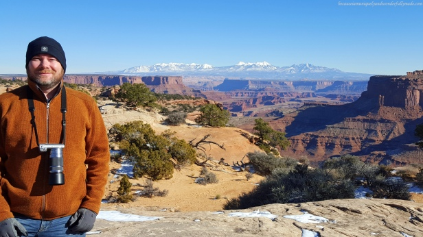 At the Shafer Canyon Overlook with the La Sal Mountains in the background at Island in the Sky district in Canyonlands National Park in Moab, Utah.