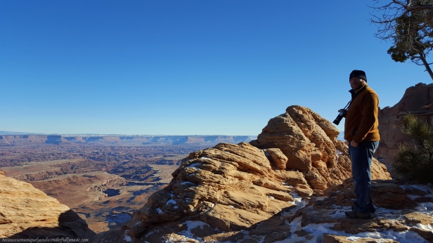 Looking down to the canyon floor from the side of the Mesa Arch at Canyonlands National Park in Moab, Utah.