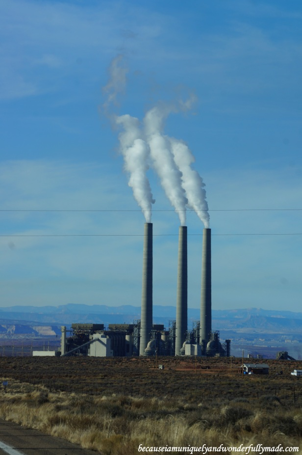 The Navajo Generating Station is a 2250 megawatt net coal-fired power plant located in this Navajo Indian Reservation in Page, Arizona. Its three tall flue gas stacks, as tall as 775 ft (236 meter) and listed among the tallest structures in Arizona, can be seen even from miles and miles away.