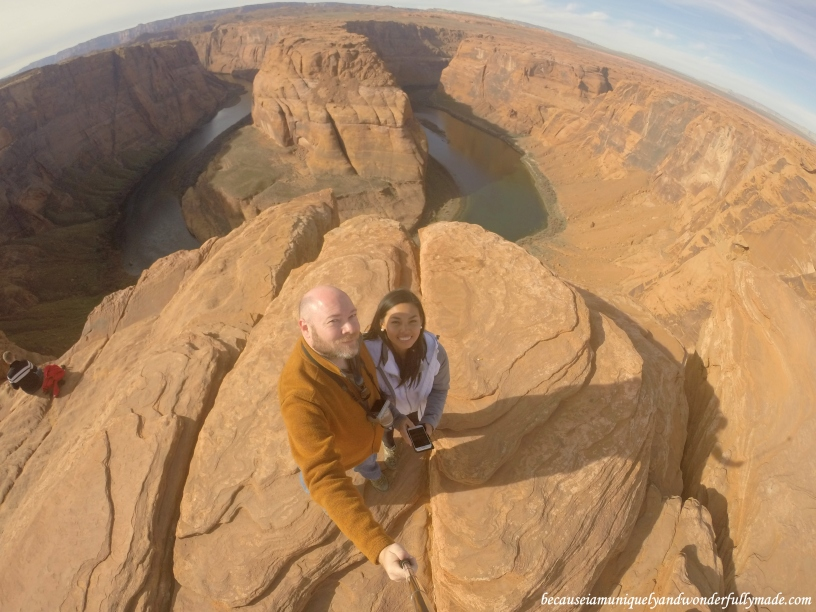 Standing at the rim of the Glen Canyon overlooking the Horseshoe Bend in Page, Arizona.