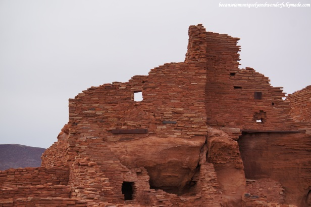 Wupatki pueblo is constructed from blocks of the local sandstone which explains its red color.