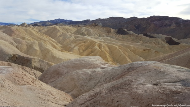The landscape surrounding Zabriskie Point at Death Valley National Park was formed by sediment from a dried-up lake.