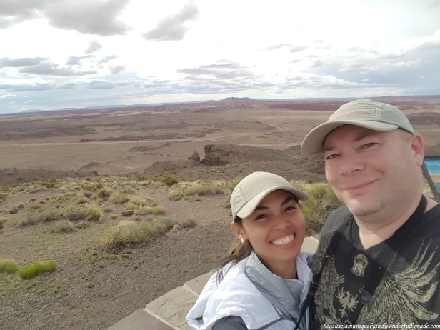 We could not resist a photo with the Painted Desert of Petrified Forest National Park in our background.