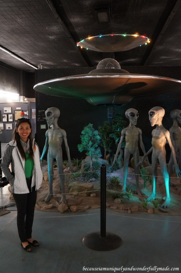 Looking extremely delighted after realizing that these life-size mechanical aliens at International UFO Museum and Research Center in Roswell, New Mexico actually move.